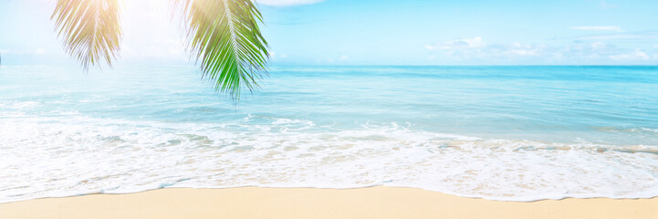 Sunny tropical Caribbean beach with palm trees and turquoise water