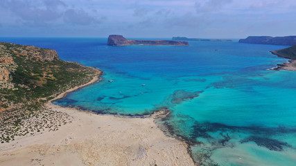 Aerial drone bird's eye view photo of tropical caribbean paradise bay and lagoon with white sandy beach and turquoise clear sea