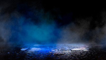 Empty dark scene with neon lights and smoke. Light neon spotlights, reflected on the wet asphalt, the surface is mirrored. Night view