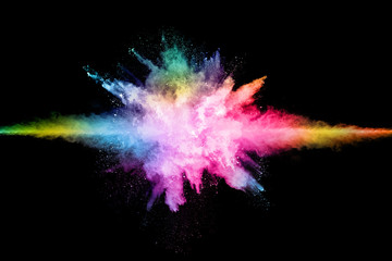 abstract colored dust explosion on a black background.abstract powder splatted background.