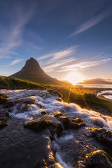 Sunlight and Kirkjufell mountain in Morning, Summer, Iceland.