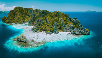 Aerial drone view of tropical Shimizu Island and pristine beach in blue ocean El Nido, Palawan, Philippines. Must see most beautiful famous nature spot Marine Reserve Park