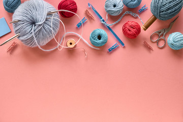 Various wool yarn and knitting needles, creative knitting hobby background