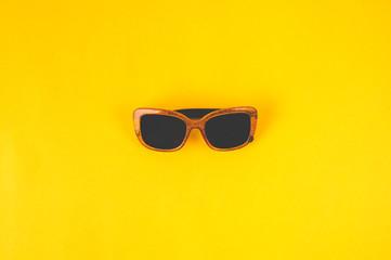 Women's sunglasses on yellow background