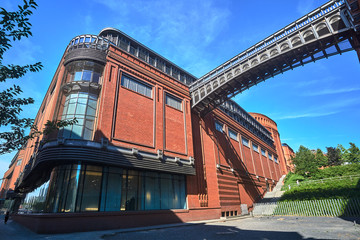 metal structure of footbridge and Red brick wall in an old brewery in Poznan.