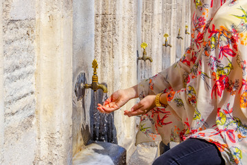 Muslim Woman Preparing To Take Ablution In Mosque