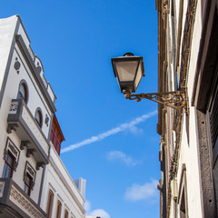 Las-Palmas de Gran Canaria, Spain, on January 5, 2018. Facade fragment of building  typical for islands of the archipelago and beautiful streetlight