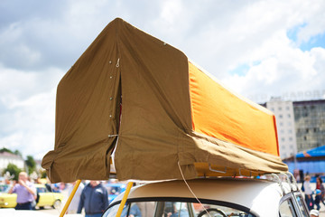 Tent on the top trunk of a car