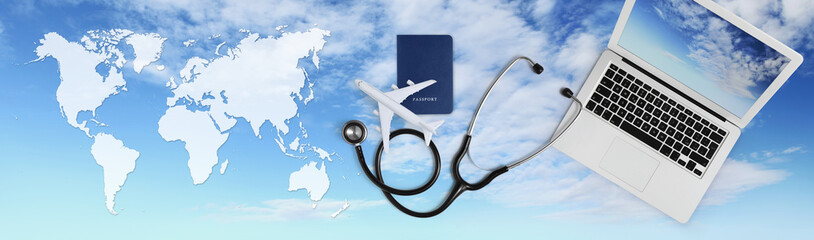 international medical travel insurance concept, stethoscope, passport, laptop computer and airplane on sky background banner with global map