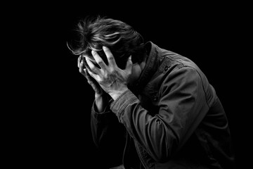 Man sad cry or strain alone on black background black & white color