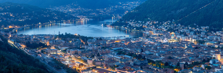 Como - The panorama of the City with the lake Como at dusk.
