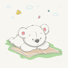 Lovely cute little bear lies on the grass and reads a book. Smart young bear, hand-drawn.