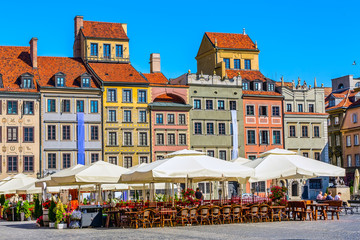 Warsaw, Poland, cafe with flowers, colorful houses in Castle Square in the Old Town of polish capital