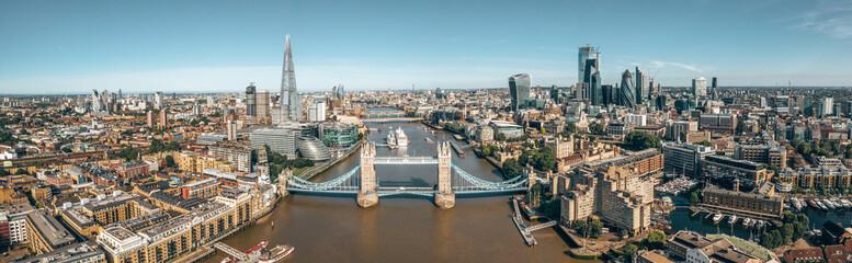 Tower Bridge in London, the UK. Bright day over London. Drawbridge opening. One of English iconic symbols.