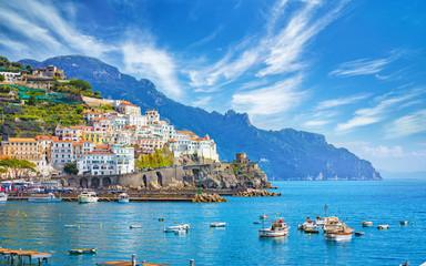 Beautiful Amalfi on hills leading down to coast, comfortable beaches and azure sea on Amalfi Coast in Campania, Italy