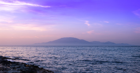 Sunset view of Cephalonia (Kefalonia) Island visible from Zakynthos Island shore.