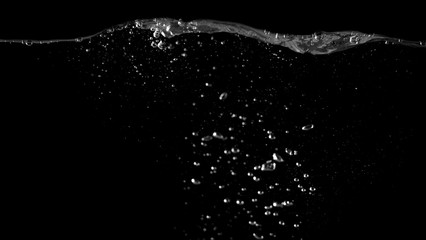 Blurry images of drinking water liquid bubbles or carbonate drink or oil shape or soda splashing and floating drop in black background for represent sparkling refreshment and refreshing