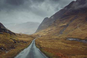 Beautiful scenic road in Glen Etive, Glen Coe Scotland. Skyfall landscape in rainy foggy weather.