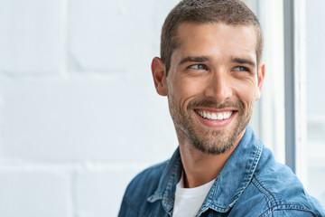 Happy smiling man looking away