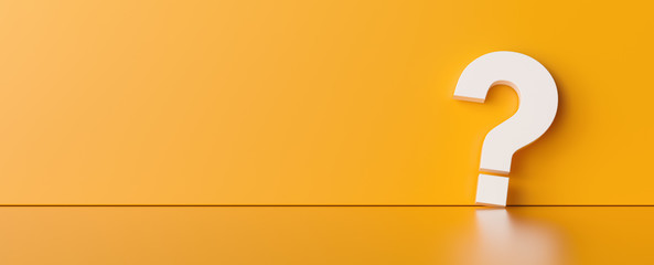 Question mark on orange wall background  - FAQ Concept image