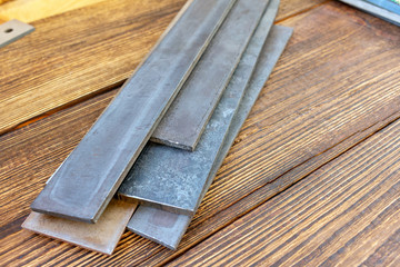 Blade steel plates handmade knife making materials supply tempered forged hardened heat treated quenched hard-tempered close up selective focus