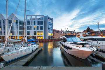 Marina of Gdansk with luxury yachts at dusk, Poland.