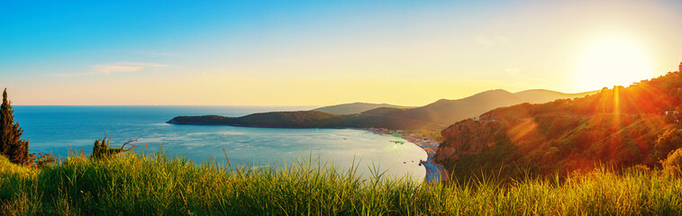 Panoramic view from above to the Adriatic sea coastline with Jaz beach at sunset time, Montenegro