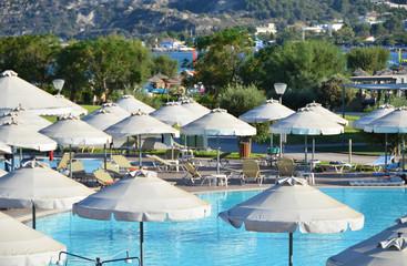 Sun umbrellas in the pool area. Rhodes, Greece