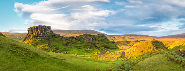 Panorama of famous mystic Fairy Glen at sunset, a green valley with romantic landscapes. Copy space in sky.