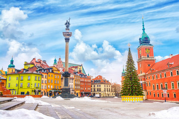 Royal Castle, ancient colorful townhouses and Sigismund's Column in Old town in Warsaw on a Christmas day, Poland, is UNESCO World Heritage Site.