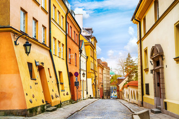Street with colorful houses in Old Town of Warsaw, capital of Poland.
