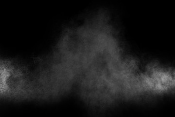 Abstract white powder explosion on a black background.Freeze motion of  white powder splash.