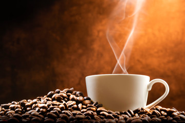 Cup of hot coffee with coffee beans