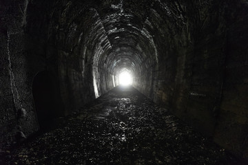 Dark and spooky railway tunnel