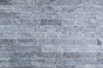 Close up shot of clean and clear rough monotone brick wall.