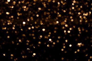 golden blur texture in black contrast