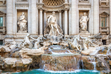 The famous fountain of the Trevi in Rome, executed in the Baroque style. Elements of the facade of the medieval palace