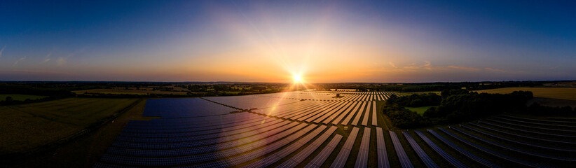 Solar farm panoramic at sunrise