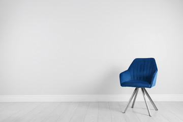 Blue modern chair for interior design on wooden floor at white wall