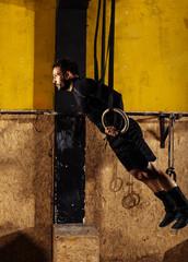 Crossfit dip ring man workout at gym dipping exercise