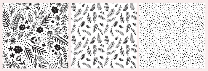 Doodle floral vector pattern set. Seamless backgrounds with hand drawn flowers, leaves, branches and dots. Graphic monochrome black and white design.