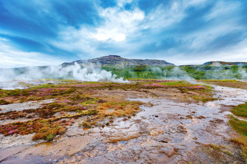 Geothermal fields Hverir. Spectacular landscape of volcanic terrain with geothermal activity in Iceland, nearby famous Hot Spring Gaysir and Strokkur, Golden Circle tourist itinerary.