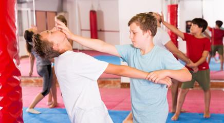 Kids exercising self-defense movements