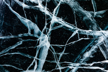 Cracked ice close up. Patterns of winter Baikal.