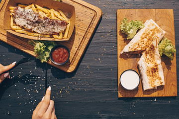 Fast food Food photo. Background. Eating. Wooden background.