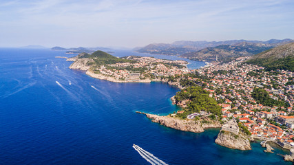 Dobrovnik, Croatia from above. Aerial drone footage of the historic city of Dubrovnik. City walls, blue sea and harbour.