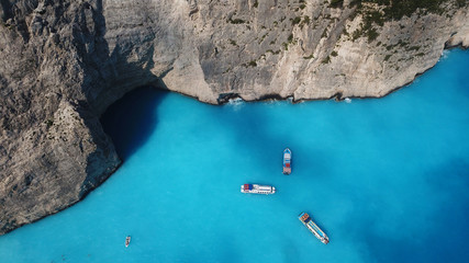 Aerial drone panoramic breathtaking view of iconic beach of Navagio or Shipwreck with deep turquoise clear sea and beautiful clouds, Zakynthos island, Ionian, Greece