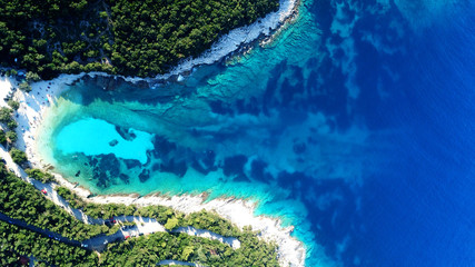 Aerial drone top view photo of exotic paradise beach of Emblisi with turquoise and emerald clear sea near iconic Fiskardo bay, Cefalonia island, Ionian, Greece