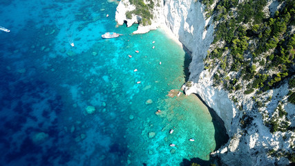 Aerial drone photo of famous white caves in small island of Marathonisi and beautiful turquoise seascape, Zakynthos island, Ionian, Greece