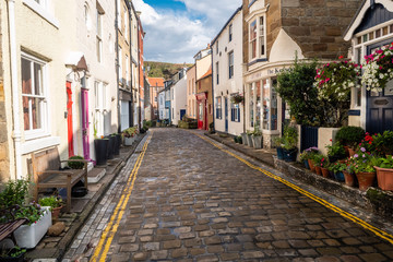 Staithes is a seaside village in the Scarborough Borough of North Yorkshire, England. Easington and Roxby Becks, two brooks that run into Staithes Beck